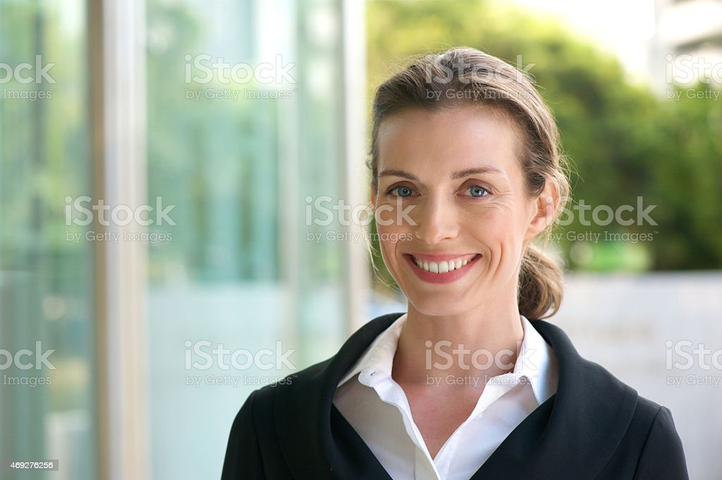 Smiling business woman with black jacket and white shirt stock photo