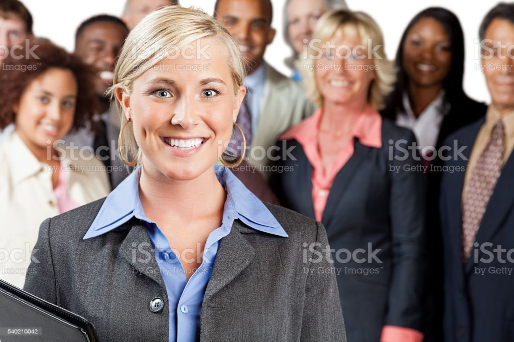 Smiling Business Woman with team stock photo
