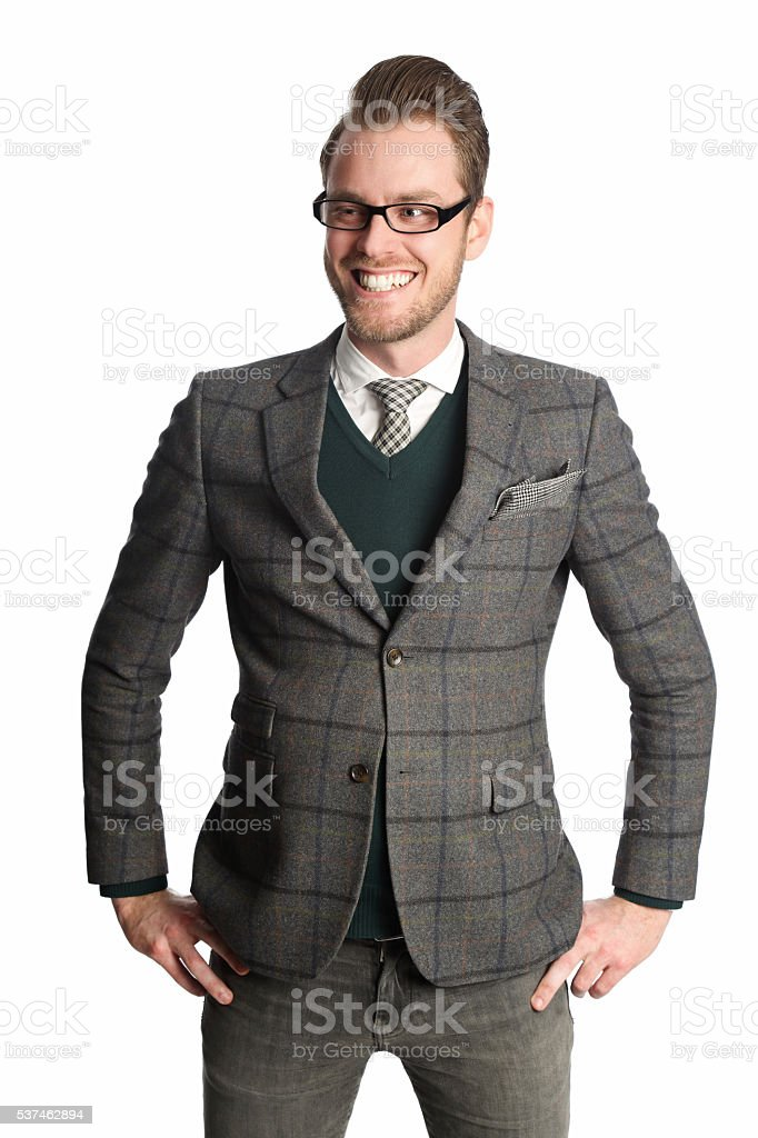 Smiling businessman against white background stock photo