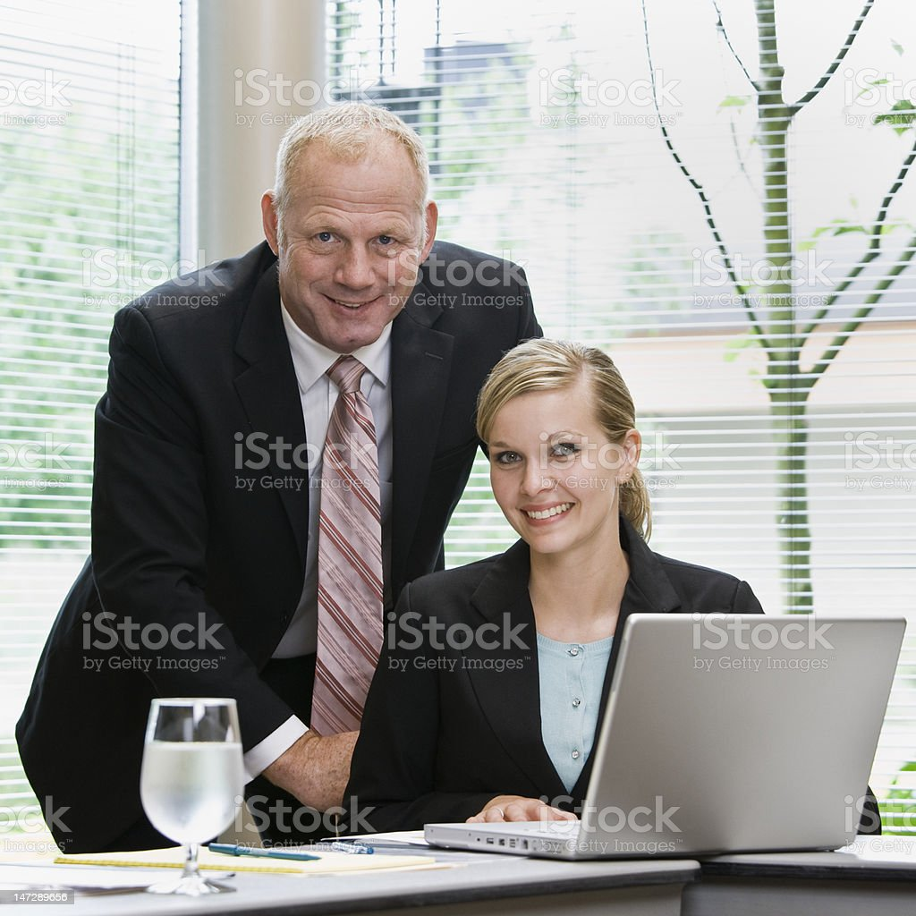 Smiling Businessman and Businesswoman royalty-free stock photo