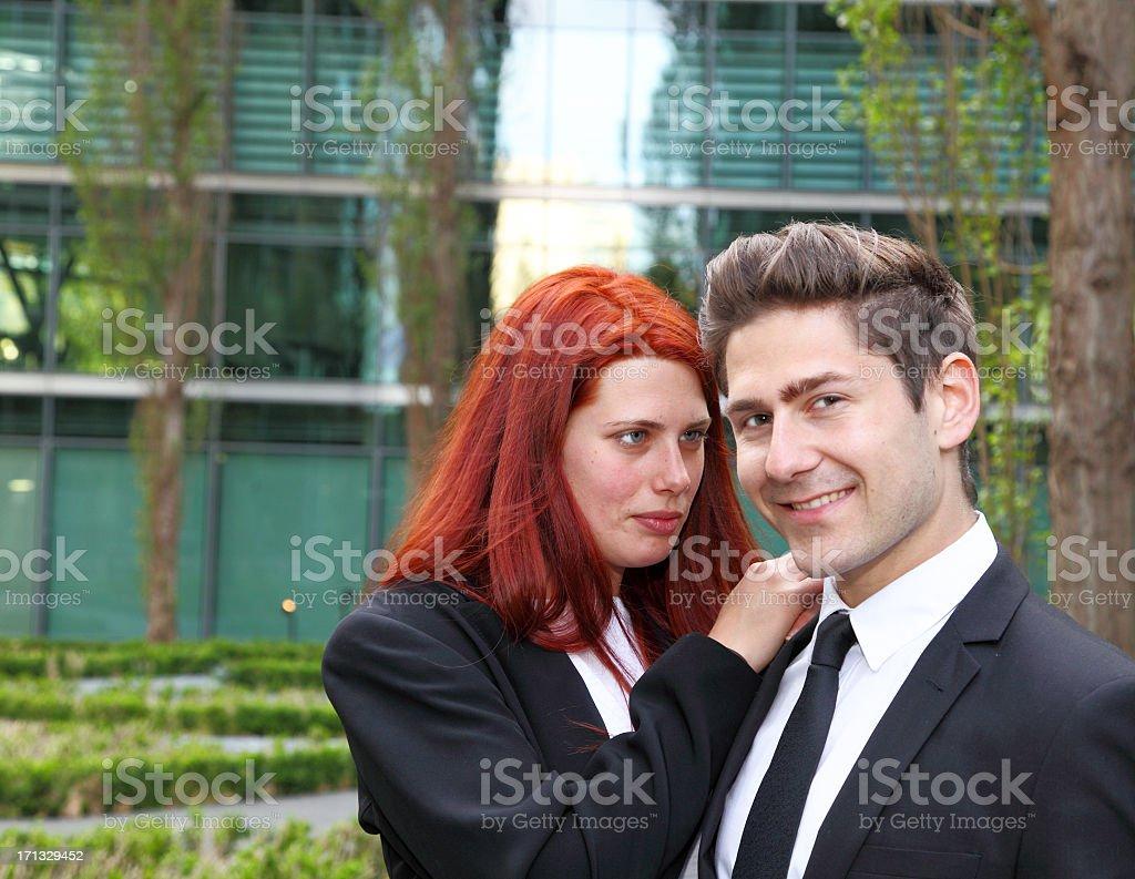 smiling businessman and his adoring secretary stock photo