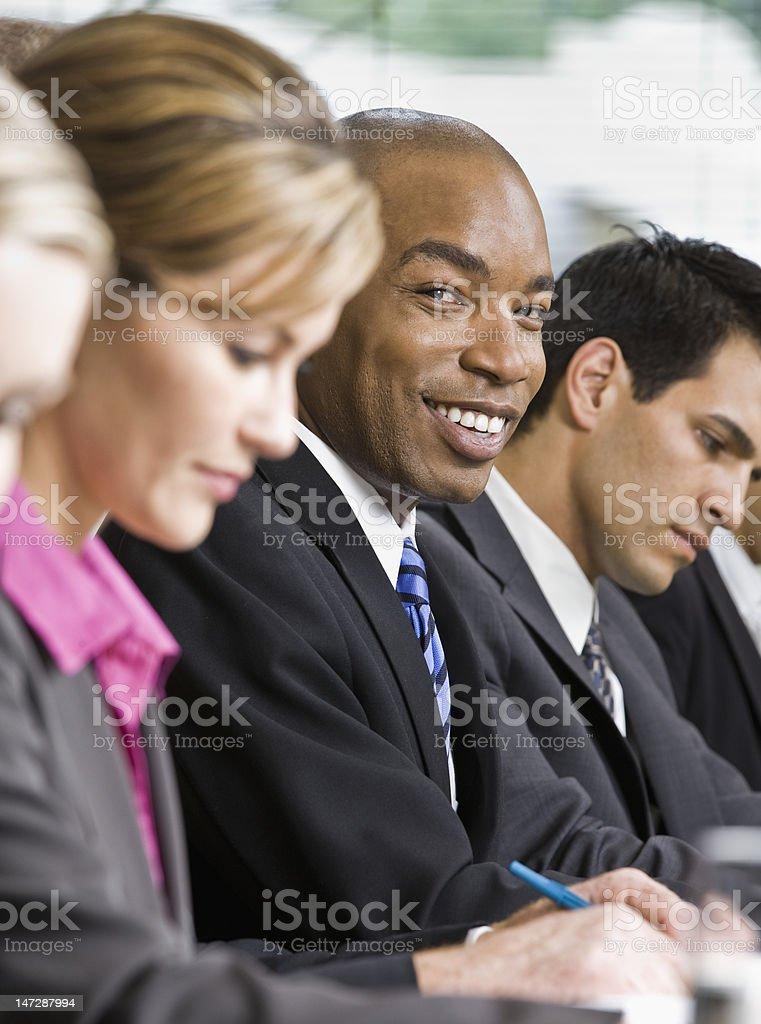 Smiling Businessman at Meeting royalty-free stock photo