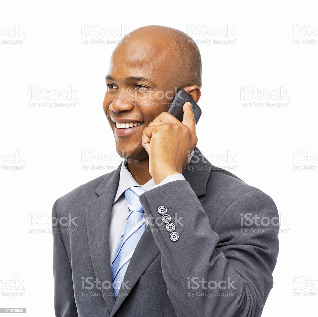 Smiling Businessman Attending Phone Call - Isolated royalty-free stock photo