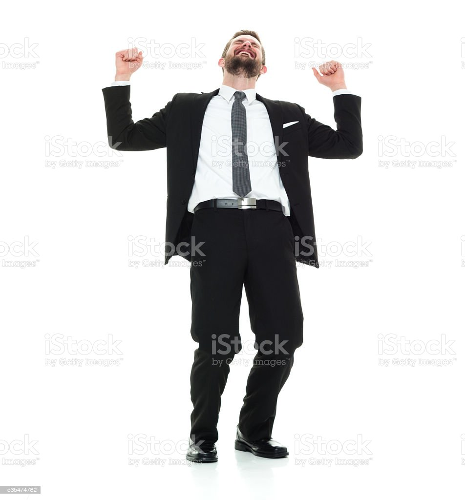 Smiling businessman cheering stock photo