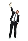 Smiling businessman cheering with money bag