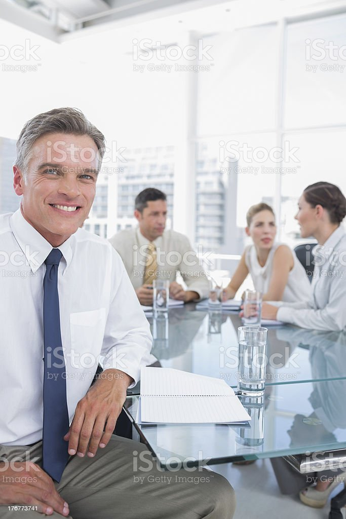 Smiling businessman during a meeting royalty-free stock photo