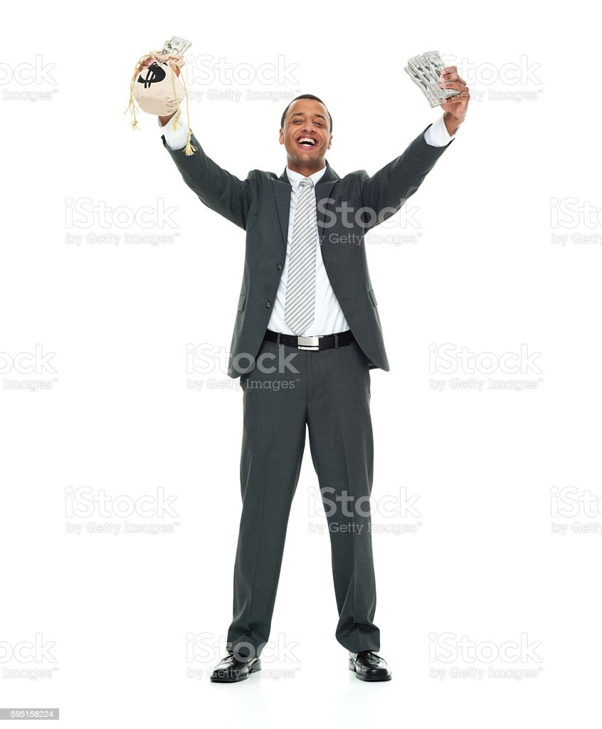 Smiling businessman excited by money stock photo