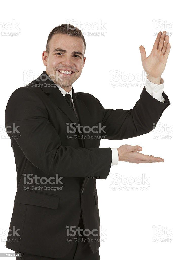 Smiling businessman gesturing royalty-free stock photo