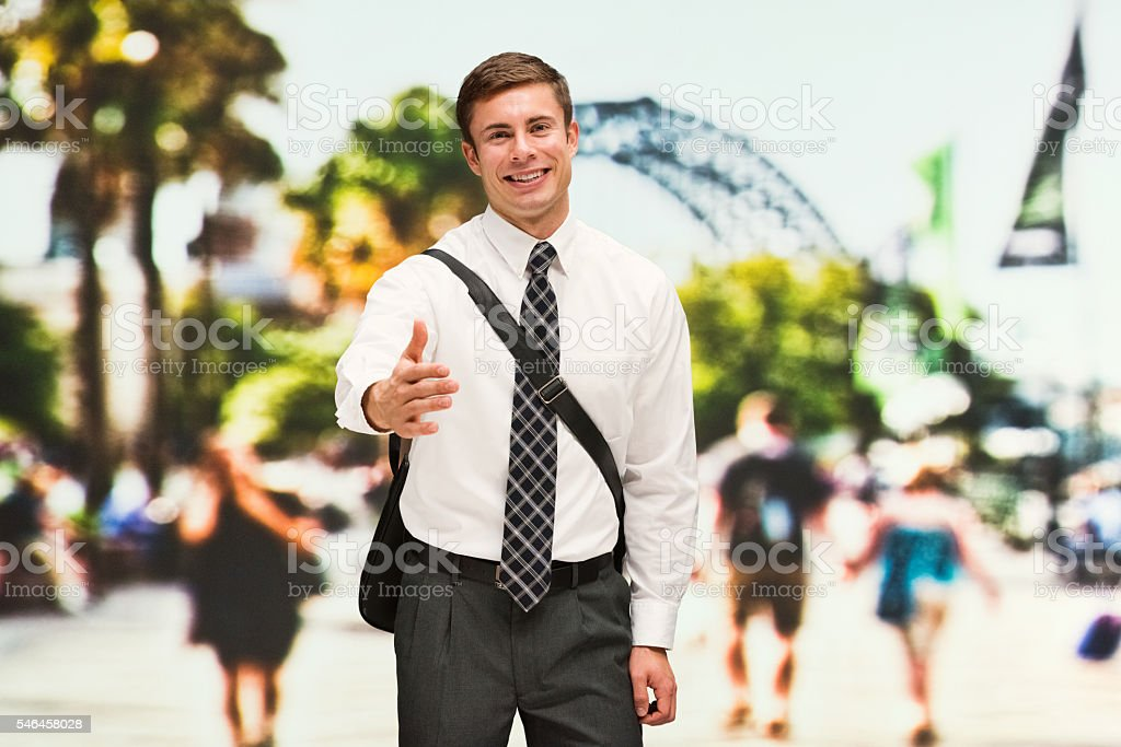 Smiling businessman gesturing stock photo