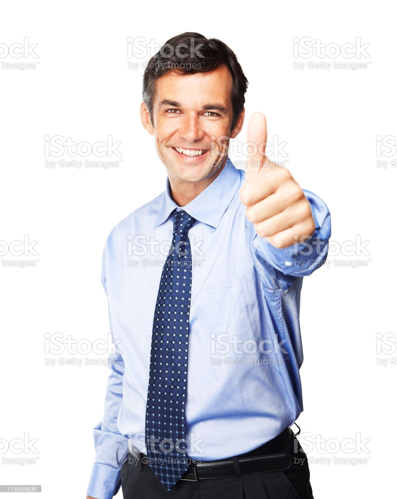 Smiling businessman giving the thumbs up royalty-free stock photo