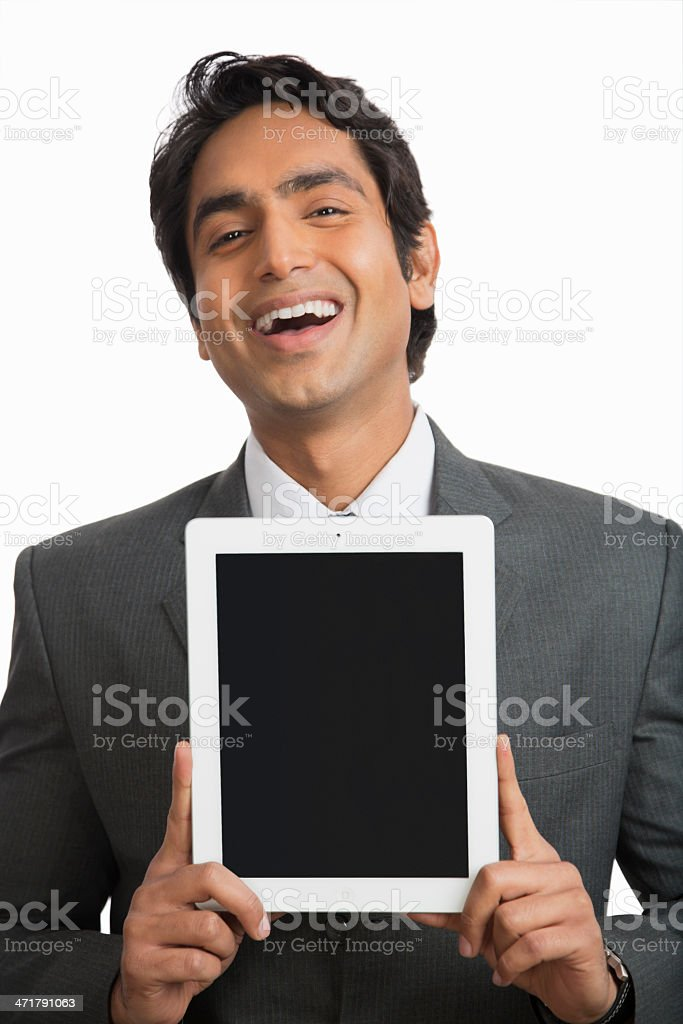 smiling businessman holding a digital tablet royalty-free stock photo
