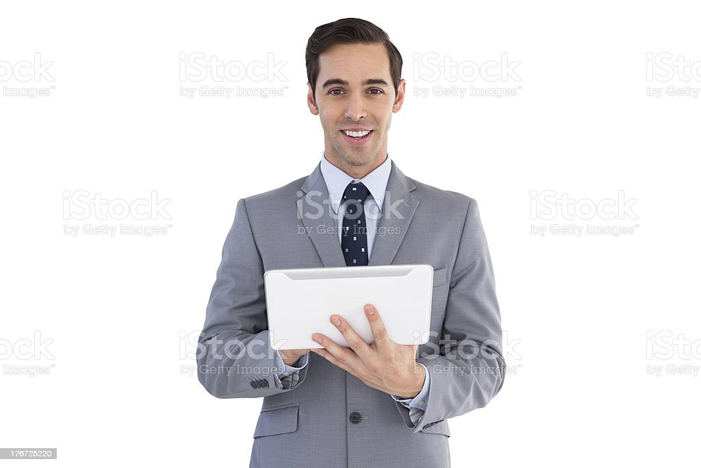 Smiling businessman holding a tablet computer royalty-free stock photo