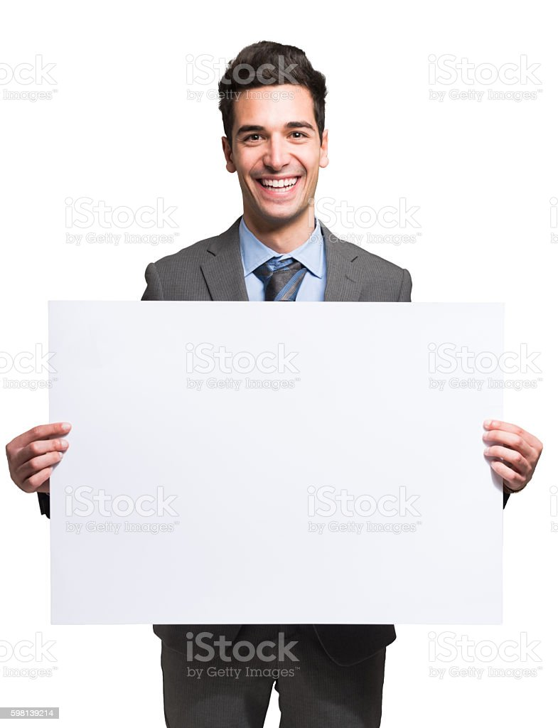 Smiling businessman holding a white board stock photo