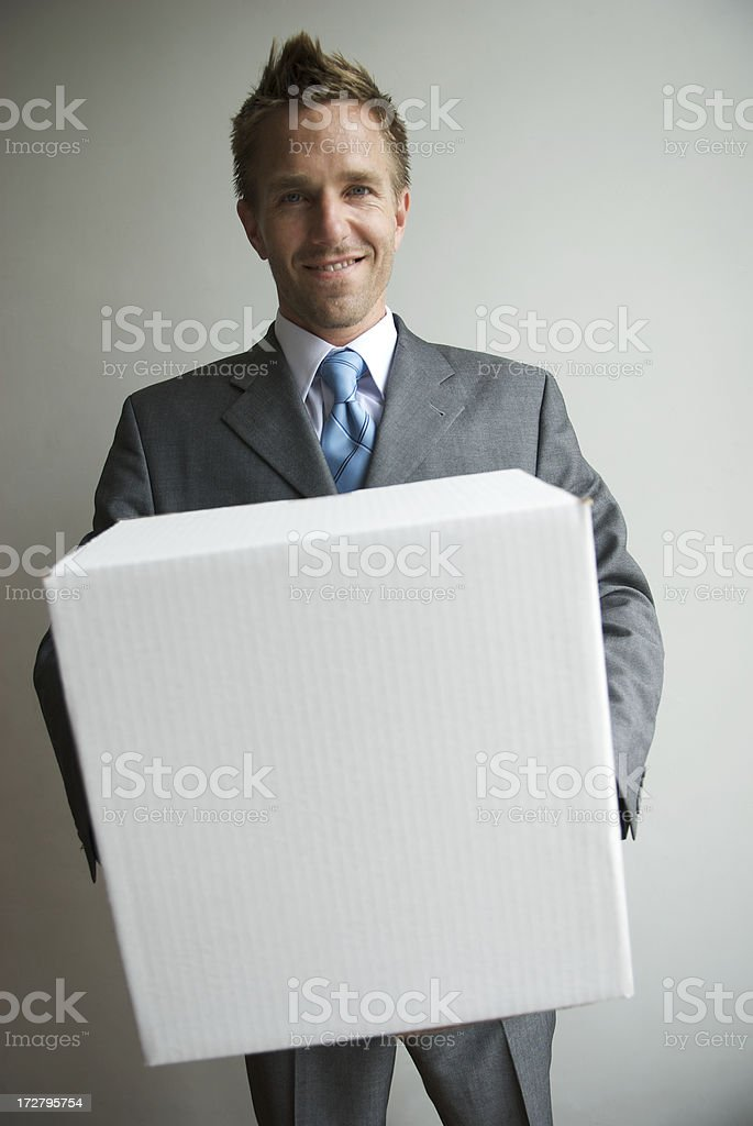 Smiling Businessman Holding Blank White Box royalty-free stock photo