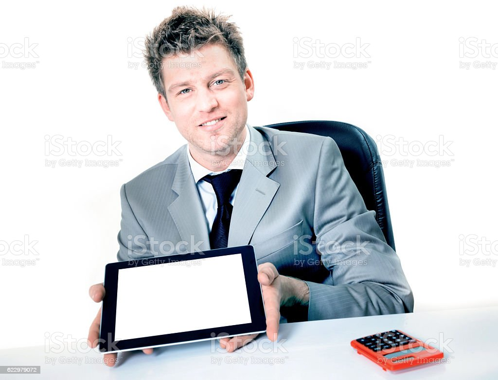 Smiling businessman holding digital tablet pc with blank screen. stock photo