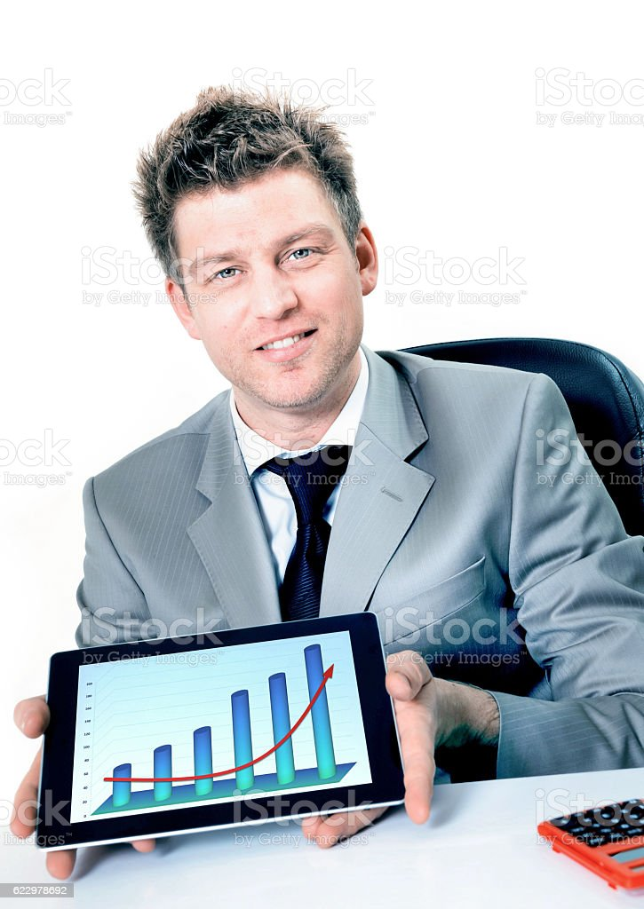 Smiling businessman holding digital tablet with positive business chart stock photo