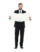 Smiling businessman holding map