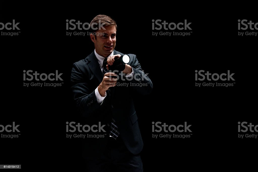 Smiling businessman in action with flash light stock photo