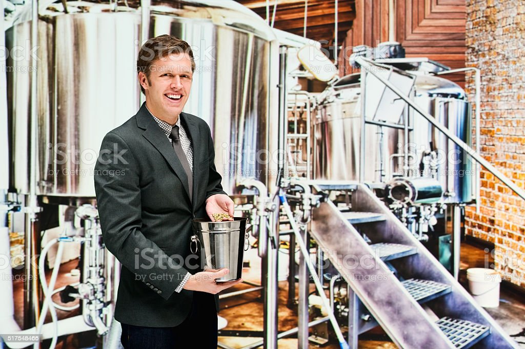 Smiling businessman in brewery stock photo