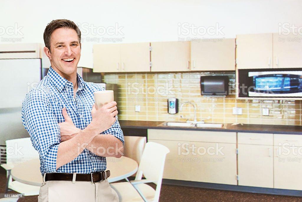 Smiling businessman in kitchen stock photo