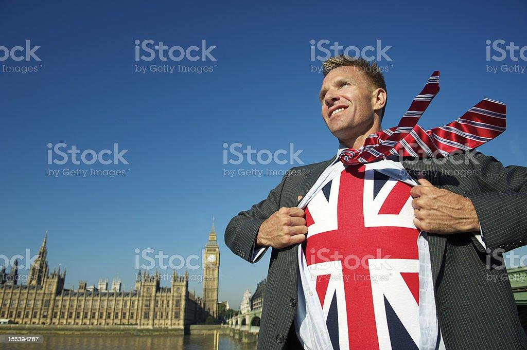 Smiling Businessman in London Reveals Patriotic Superhero royalty-free stock photo
