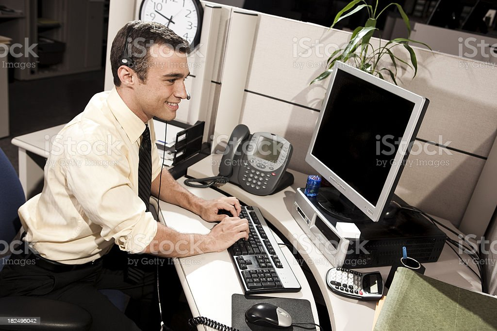 Smiling Businessman in Office Cubicle royalty-free stock photo