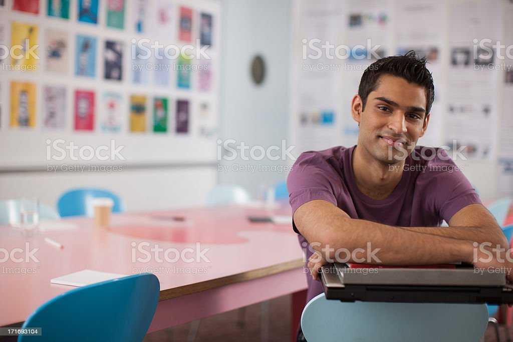 Smiling businessman in office stock photo