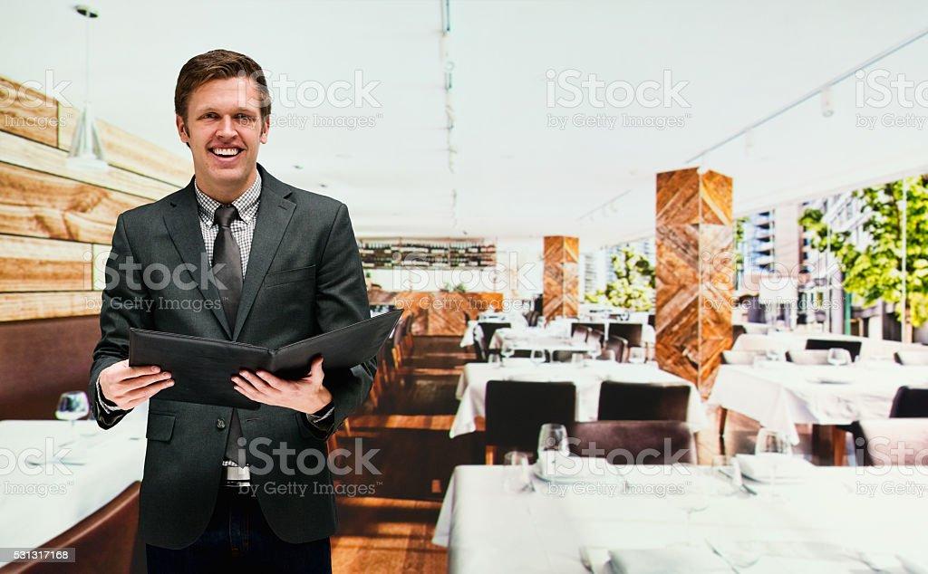 Smiling businessman in restaurant stock photo