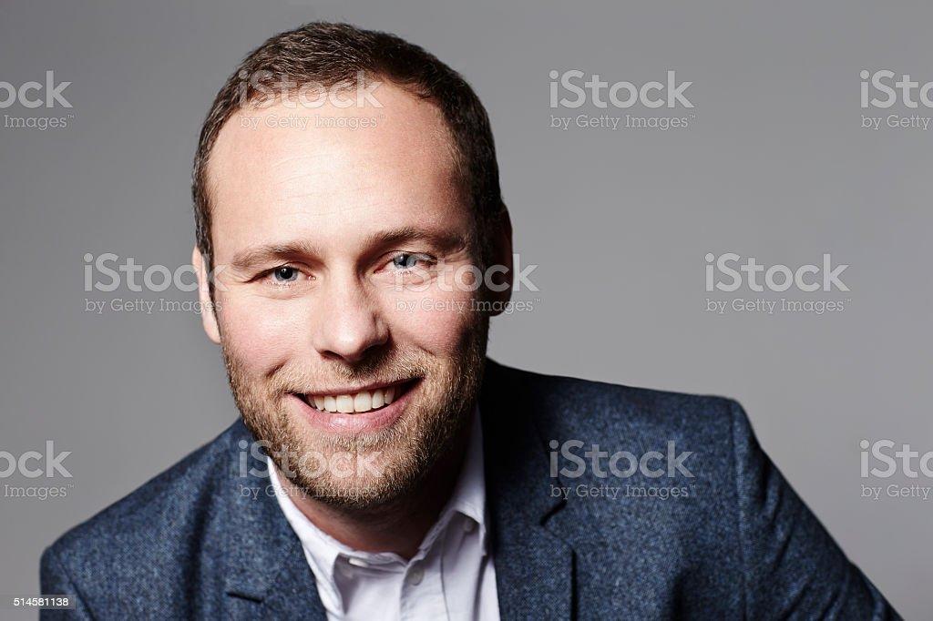 Smiling businessman in studio shot stock photo