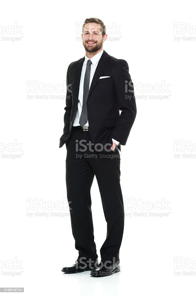 Smiling businessman looking at camera stock photo