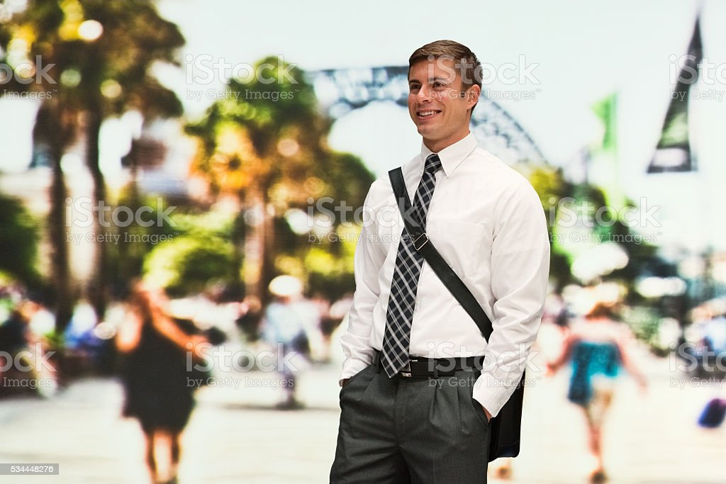 Smiling businessman looking away stock photo