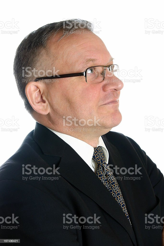 Smiling businessman looking up stock photo