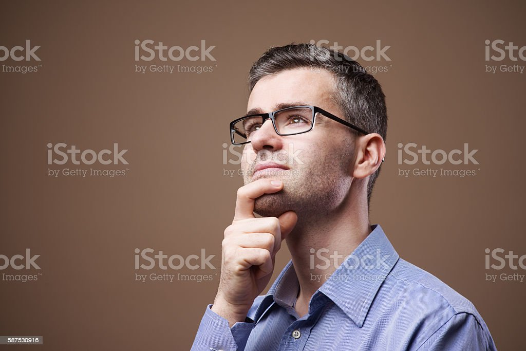 Smiling businessman making plans stock photo