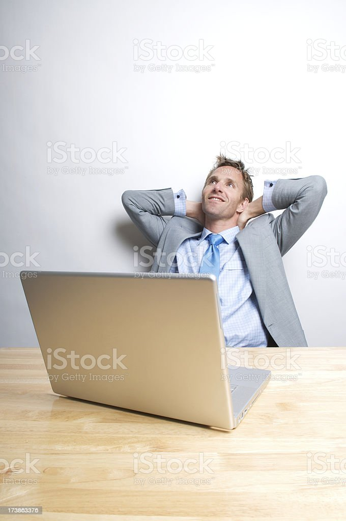 Smiling Businessman Office Worker Leaning Back at Desk royalty-free stock photo
