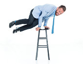 Smiling businessman on stool
