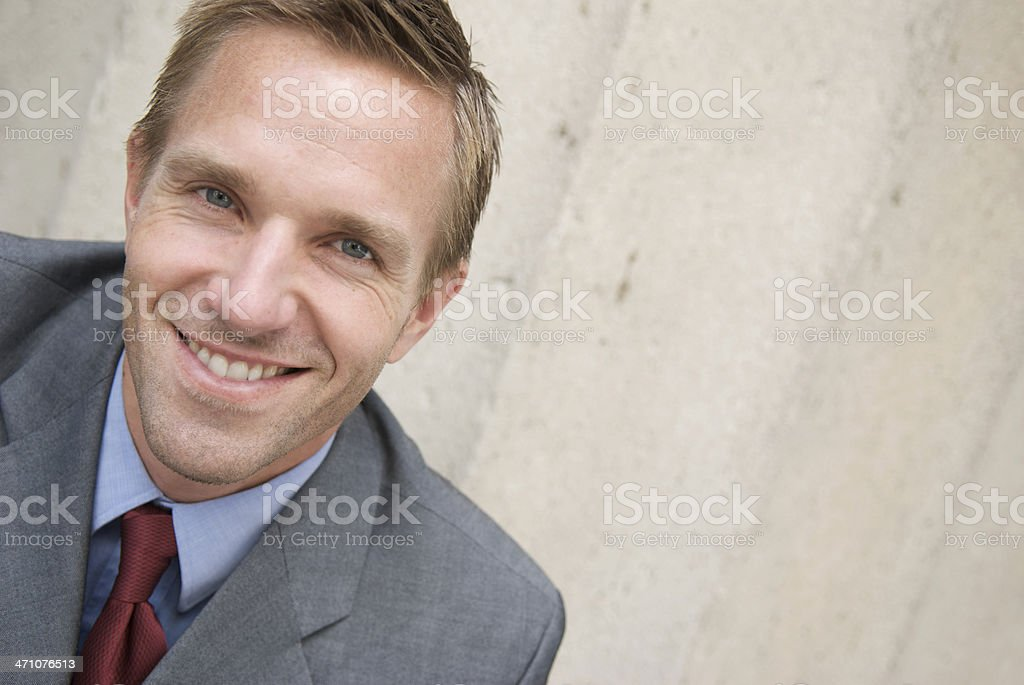 Smiling Businessman Outdoors Head and Shoulders Portrait From Above royalty-free stock photo