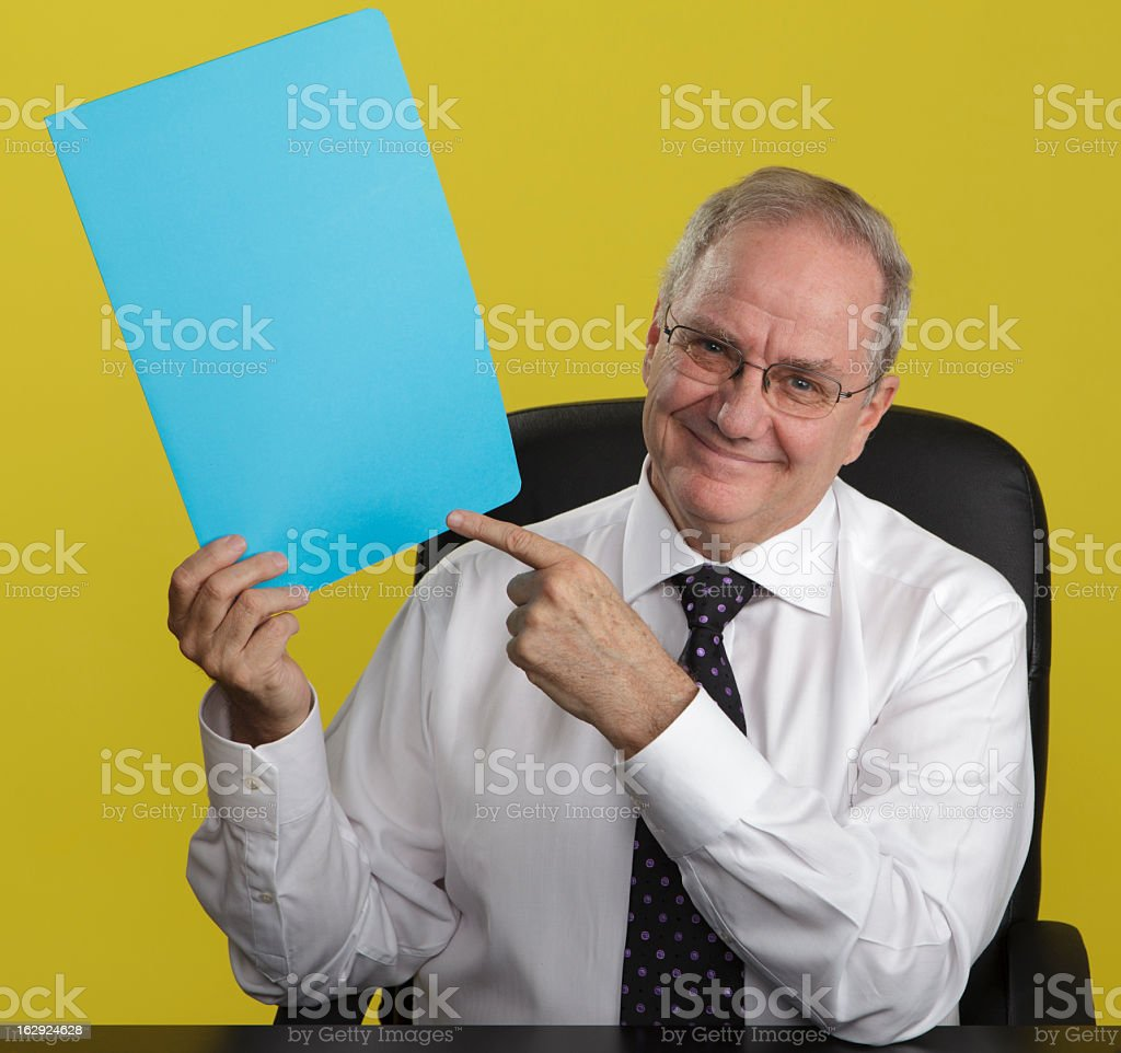 Smiling Businessman Pointing at Blank Sign royalty-free stock photo