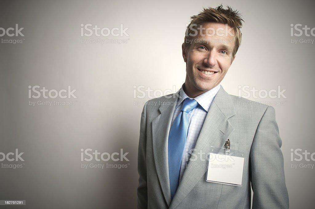 Smiling Businessman Portrait w Blank Name Tag stock photo