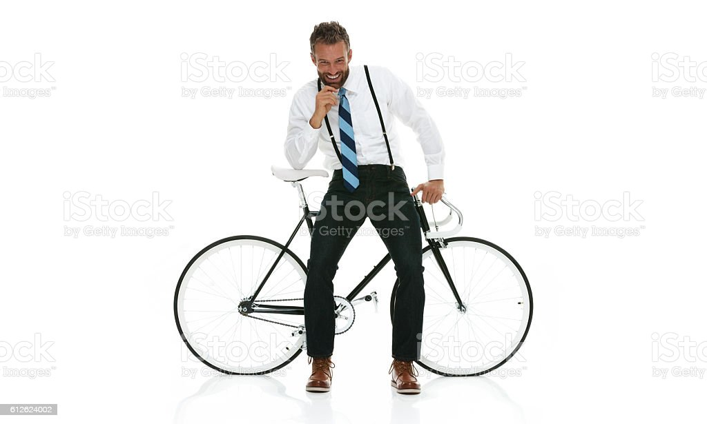 Smiling businessman sitting on bicycle stock photo