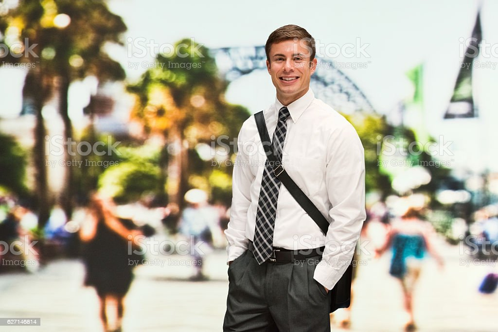 Smiling businessman standing outdoor stock photo