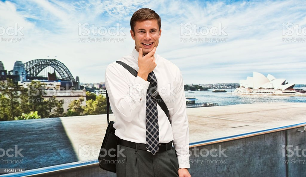 Smiling businessman standing outdoors stock photo