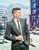 Smiling businessman standing outdoors