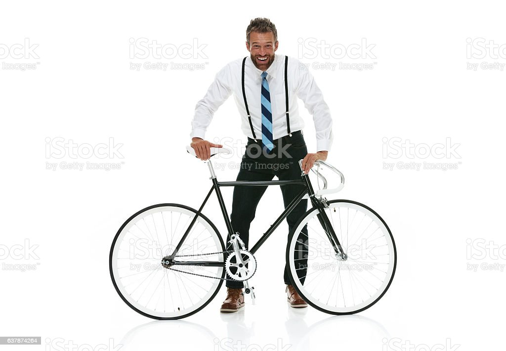 Smiling businessman standing with bicycle stock photo