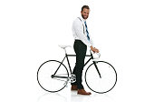 Smiling businessman standing with bicycle