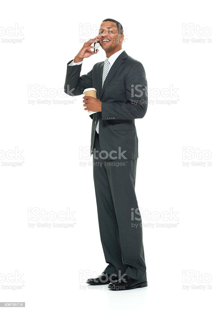 Smiling businessman talking on mobile stock photo