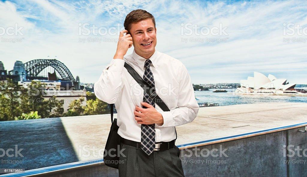 Smiling businessman thinking outdoors stock photo