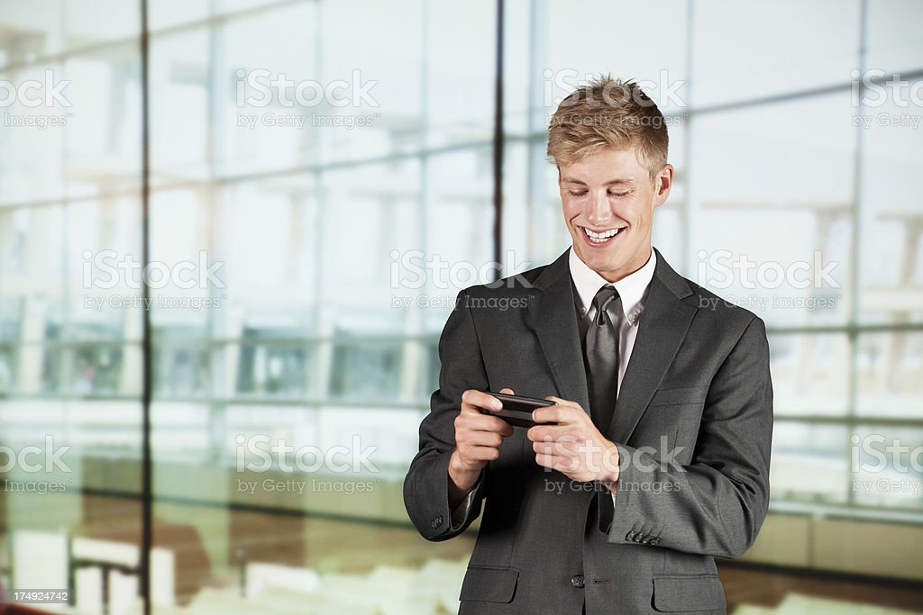 Smiling businessman using a mobile phone royalty-free stock photo