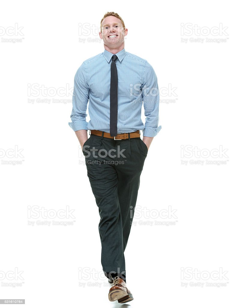 Smiling businessman walking stock photo