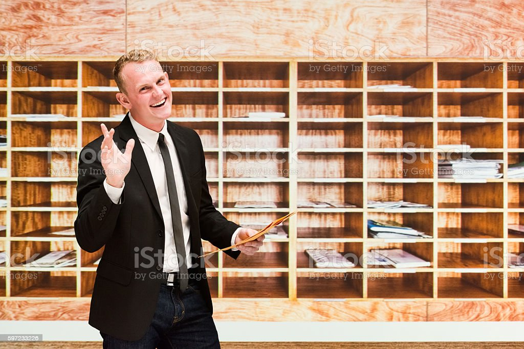 Smiling businessman waving hand stock photo
