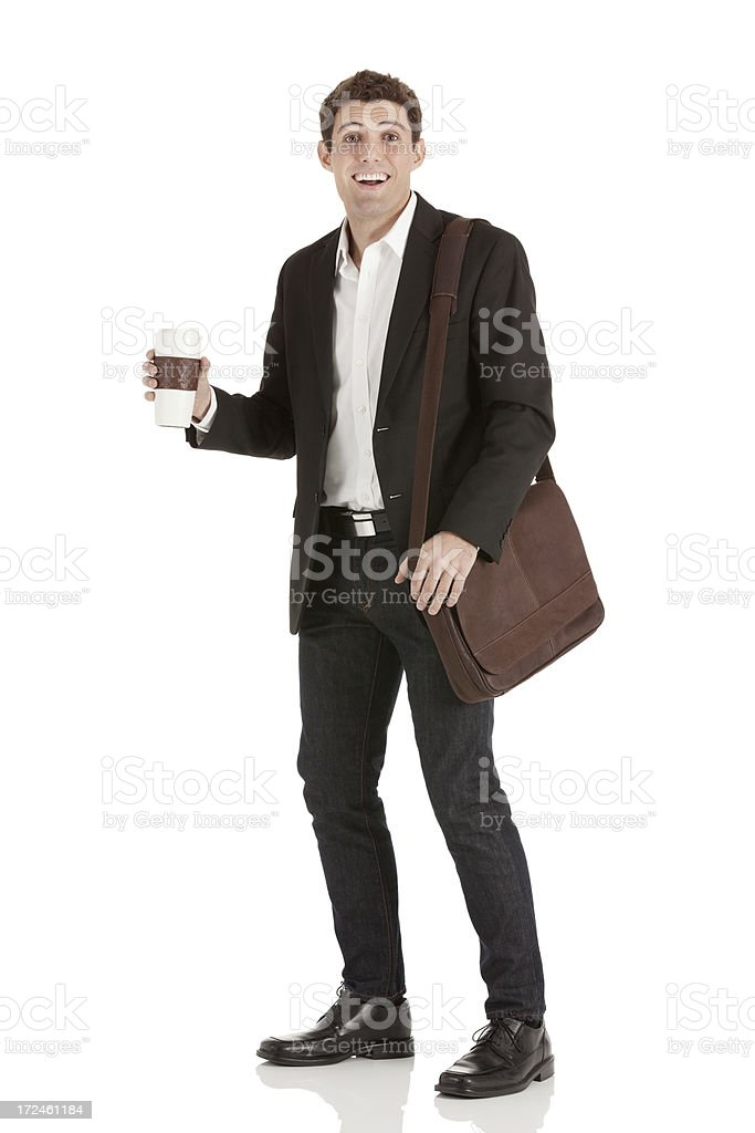 Smiling businessman with a coffee cup royalty-free stock photo